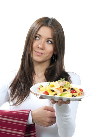 Waitress, chef hold healthy plate with italian spaghetti pasta pappardelle, tagliatelle, macaroni with tomatoes, shrimps and olives on serviette, table napkin in other on a white background photo