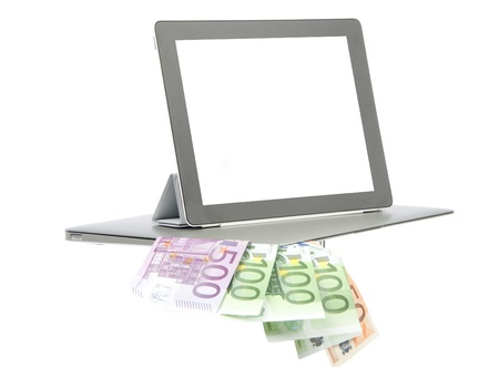 Modern popular laptop and new electronic tablet touch pad notebook screen money euro isolated on a white background  photo