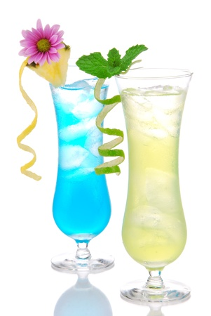 blue hawaiian drink: Cocktails margarita martini row with vodka, light rum, gin, tequila, blue curacao, lime juice, lemonade, lemon slice and fresh summer flowers in martinis cocktail glass on a white background