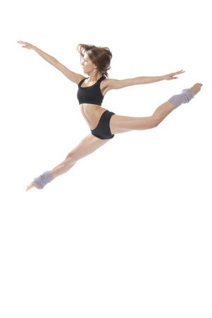 New slim jazz modern contemporary style woman ballet dancer jumping isolated on a white studio background  photo