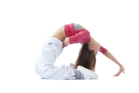 Pretty flexible dancer woman stretching, warming up on a white background