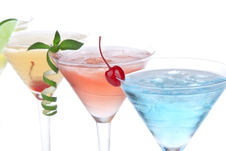 horizontal bar: Summer Tropical Martini Cocktails with vodka, apple and peach liqueur, pineapple and cranberry juice, lime, lemon, blue curacao, maraschino cherry, and orchid isolated on a white background