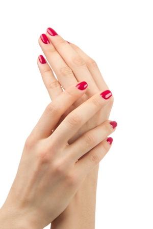 Mooie Vrouwelijke Handen rode manicure schellak concept op een witte achtergrond