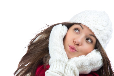 Closeup portrait of young pretty woman in winter hat and glows blowing air isolated on a white background Stock Photo - 12118109