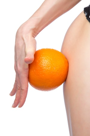 Hip and orange in hand cellulite liposuction weight loss control concept isolated against white background