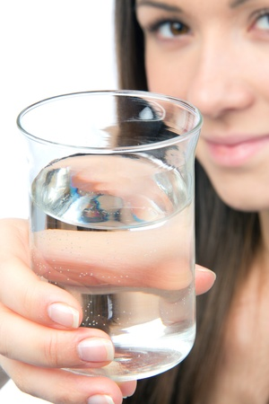 Healthy lifestyle weight loss concept. Woman give drinking water isolated on a white background