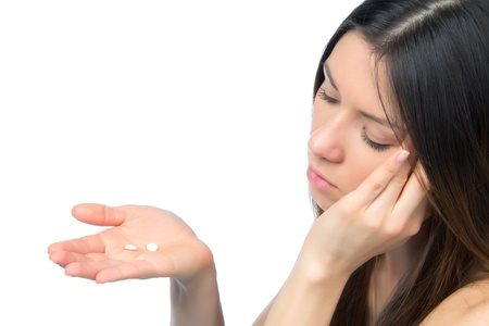 Woman with headache hold pills medicine tablets in hand against white background Stock Photo - 12118140