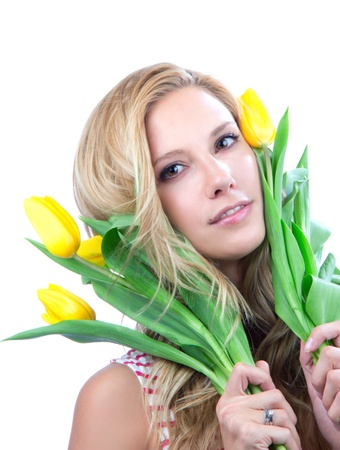 Portrait of young blonde woman with yellow spring tulips bouquet of flowers smiling isolated on white background  Stock Photo - 12118166