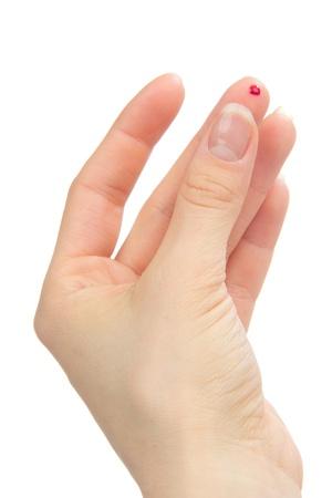Diabetes lancet in de hand prikken vinger om lekke banden te leveren aan kleine bloedmonsters voor bloedglucose te verkrijgen, hemoglobinegehalte test met glucometer geïsoleerd op een witte achtergrond