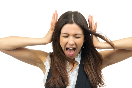 emotional intelligence: Woman angry yelling frustrated screaming out loud and pulling her hair with closed eyes  isolated on a white background