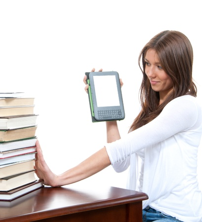 kindle: Female compare books and new wireless reading digital ebook Device isolated over white background  Stock Photo
