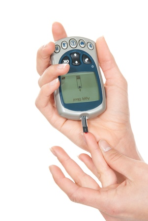 dependent: Dependent first type Diabetes patient measuring glucose level blood test using ultra mini glucometer and small drop of blood from finger and test strips isolated on a white background