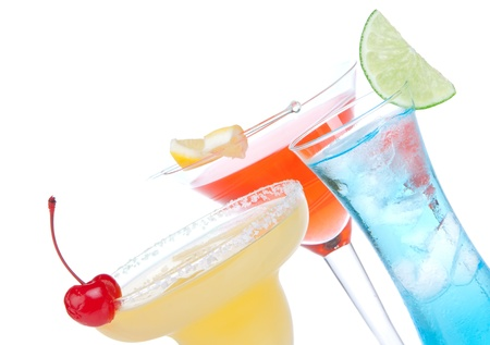 Margarita, martini cocktails, tequila sunrise, iced tea, tequila sunrise in cocktail glasses with mint, cherries, lemon spiral, lime, soda isolated on a white background  photo