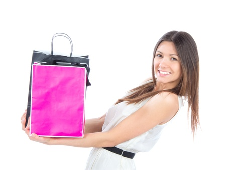 Pretty young woman with shopping bags buying presents, smiling and looking at the camera isolated on a white background Stock Photo - 12770347