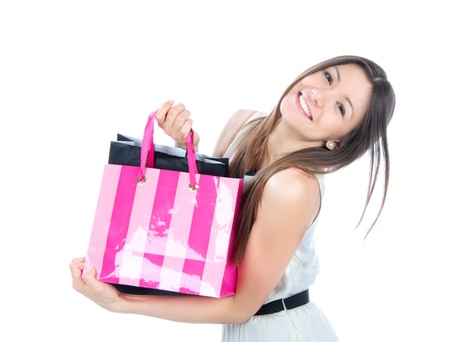 Pretty young woman with shopping bags buying presents, smiling and looking at the camera isolated on a white background  Stock Photo