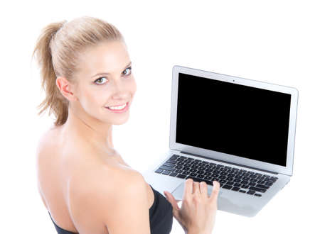 Young business woman with new modern popular laptop keyboard smiling isolated over white background  Stock Photo - 12770362