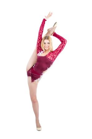 Slim flexible woman rhythmic gymnastics art dancer stand on splits isolated on a white background photo