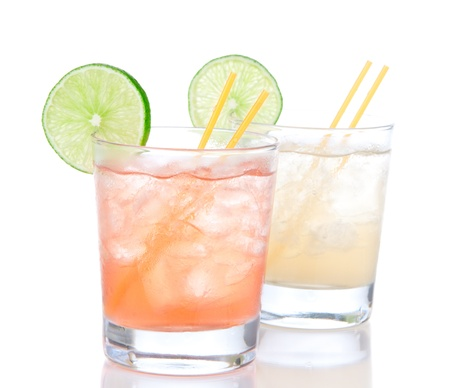 Alcohol margarita cocktails or long island Iced tea with lime in short cocktail glasses isolated on a white background  photo