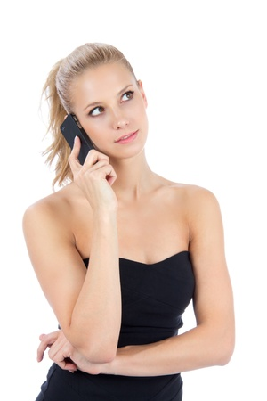 Pretty business woman talking on the mobile phone, smiling and looking at the corner on a white background  photo