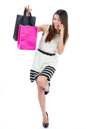 wench: Full Body Happy Beautiful sexy woman with colorful gift shopping bags cheerful smiling in contemporary casual dress on a white background