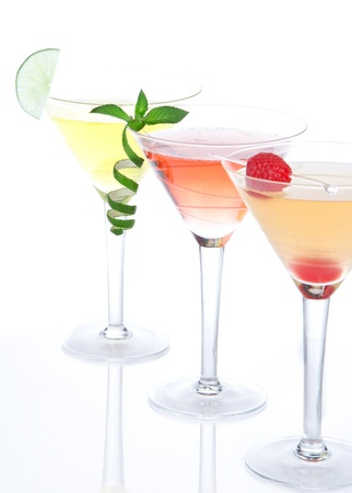 Cocktails alcohol drinks spirits mai tai, margarita, martini in cocktail glasses on a white background. Focus on mint photo