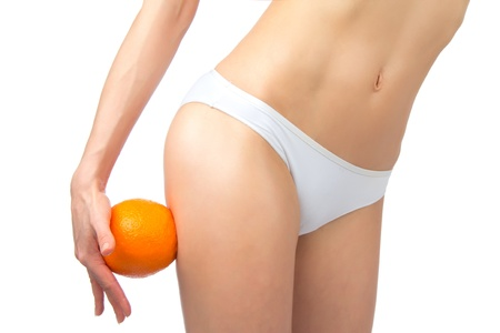 Hip, legs, abdomen and orange in hand cellulite liposuction woman weight loss control concept isolated against white background  photo