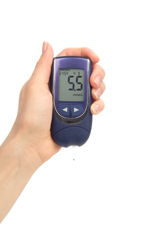 blood glucose: Hand with Diabetic glucometer for measuring glucose level blood test  isolated on a white background