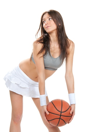 Pretty brunette woman hold Basketball ball in hand and smiling in short skirt  isolated on a white background  photo