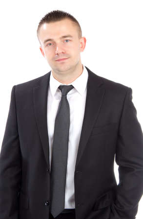 Portrait of a young casual business man standing against white background