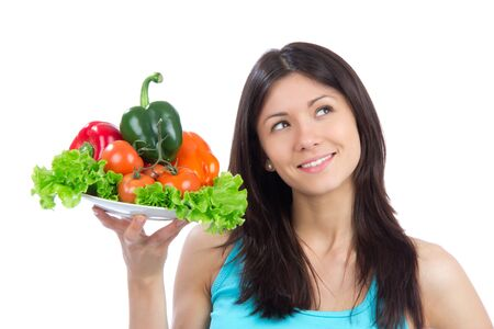 Young woman with plate of fresh healthy vegetarian vegetables salad, peppers, tomatoes isolated on a white background photo