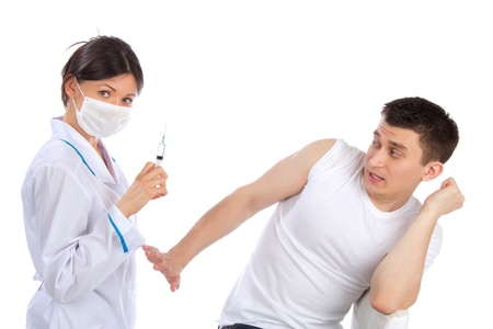 Doctor with syringe needle and man fear of injections phobia concept against white background.