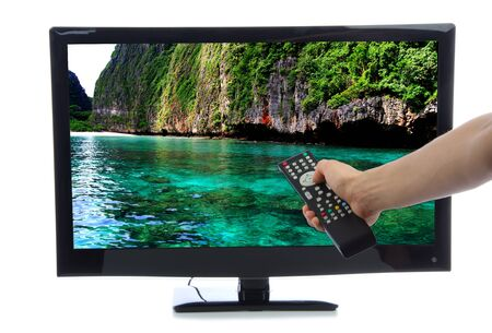 Hand with remote control turning on Plasma LED LCD TV with beautiful relax ocean water on screen isolated on a white background Stock Photo - 13223189