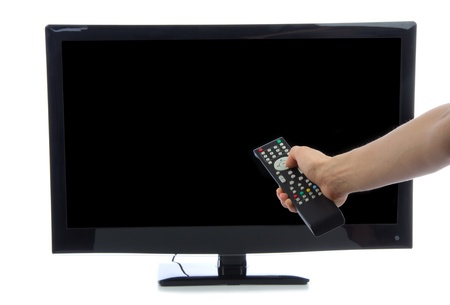 Hand with remote control turning on Plasma LED LCD tv with black copy-space screen isolated on a white background Stock Photo - 13223169