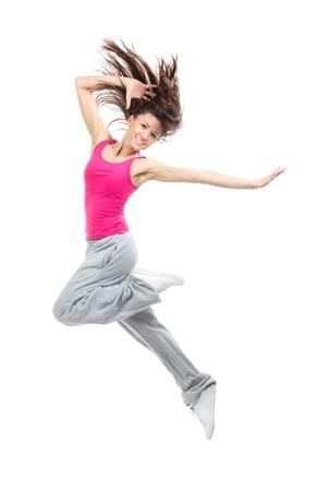 現代の 10 代の少女ダンサー ジャンプと、白い背景で隔離のヒップホップを踊る 写真素材
