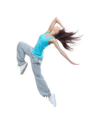 Modern teenage girl dancer dancing hip-hop isolated on a white background Imagens