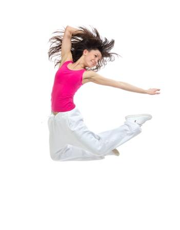 新しいかなりモダンなスリムなヒップホップ スタイルの 10 代の少女ダンス スタジオの白い背景で隔離のジャンプ 写真素材