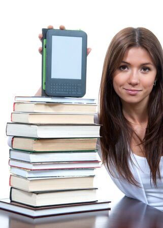 Woman with stack of books and new wireless reading digital ebook Device Stock Photo - 13682612