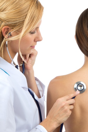 Doctor woman auscultating young patient by stethoscope isolated on a white background photo