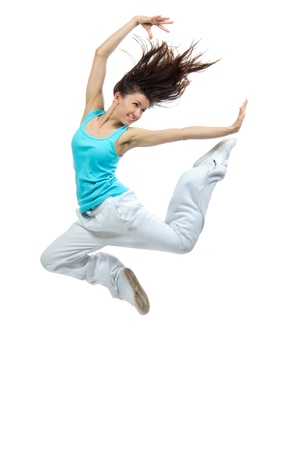modern slim hip-hop style teenage girl jumping dancing isolated on a white studio background Reklamní fotografie
