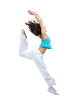New pretty modern slim hip-hop style teenage girl jumping dancing isolated on a white studio background photo