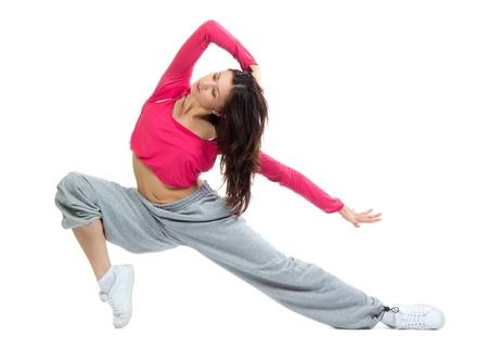 tanieć: Współczesne ocieplenie dziewczyna tancerka w górÄ™, taniec, rozciÄ…ganie na biaÅ'ym tle