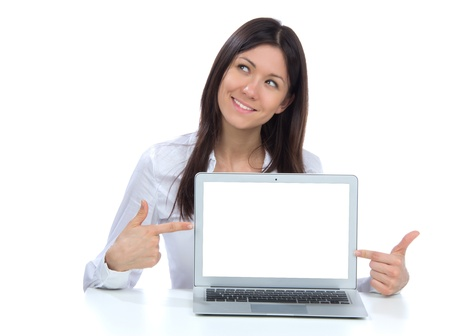 Young business woman with new modern popular laptop keyboard with white screen for text space smiling isolated over white background Stock Photo - 15196616