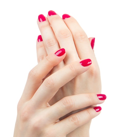 Beautiful Female Hands red manicure shellac  near face concept on a white background. Focus on hand photo