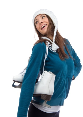 Woman with ice skates getting ready for ice skating winter sport activity in hat smiling isolated on a white background  photo