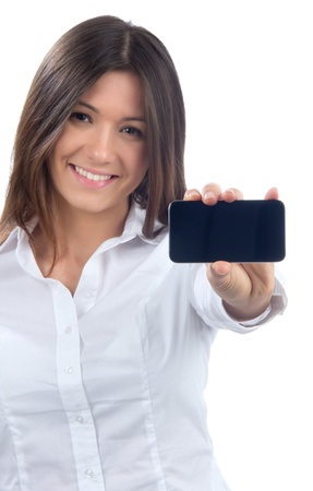mobile communication: Young Pretty Woman Showing display of her new touch mobile cell phone on a white background. Focus on the hand and phone Stock Photo
