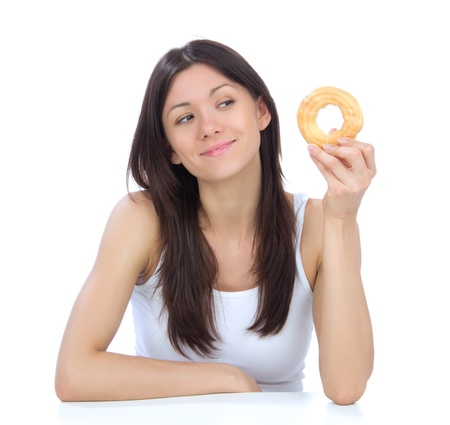 junk: Woman enjoy sweet donut. Unhealthy junk food concept isolated on a white background
