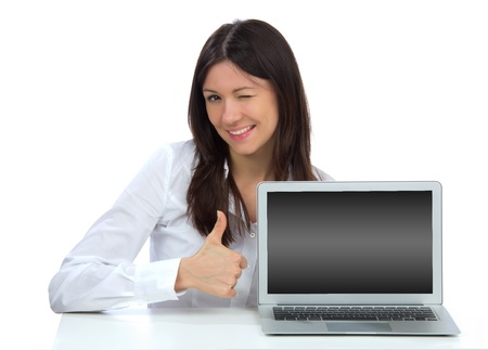 Young student woman with new modern popular laptop keyboard thumb up smiling isolated over white background Stock Photo - 15400117