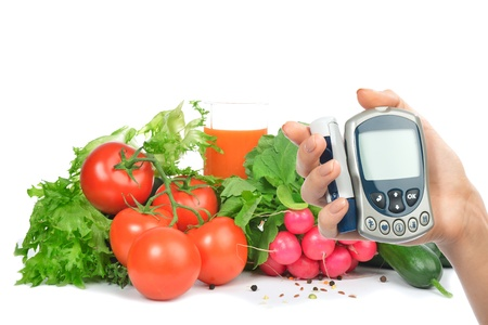 Diabetes concept glucose meter in hand and healthy organic food photo