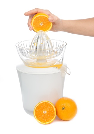 squeeze: Preparing fresh orange juice squeezed with electric juicer on a white background
