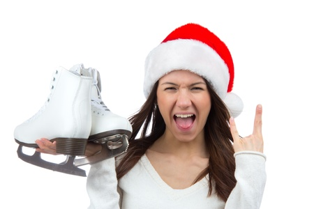 Woman with ice skates getting ready for ice skating winter sport activity in christmas santa hat screaming or yelling isolated on a white background photo